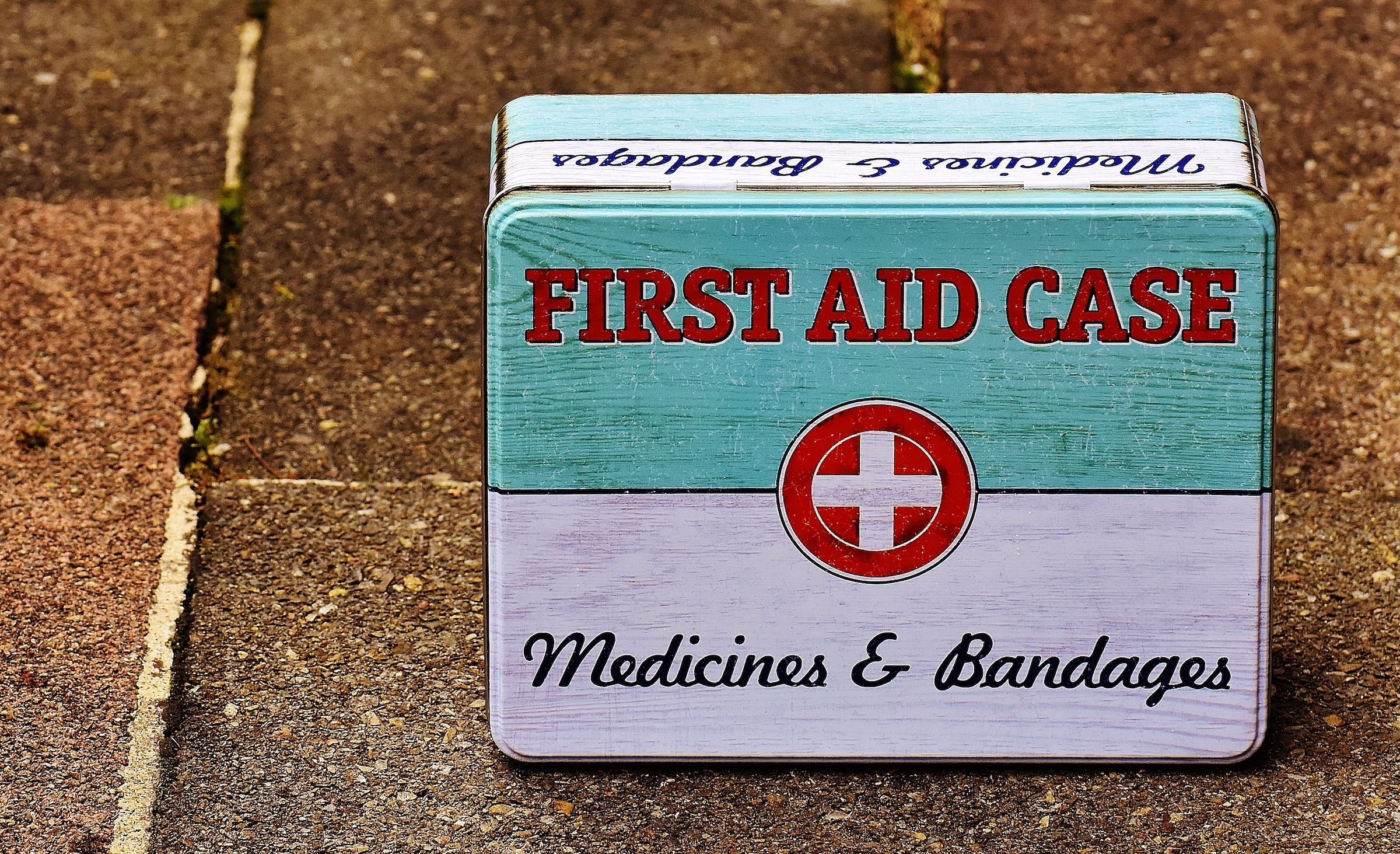 First aid case of medicine and bandages