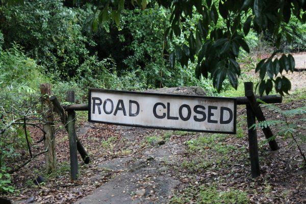 Road Closed Sign blocking path.