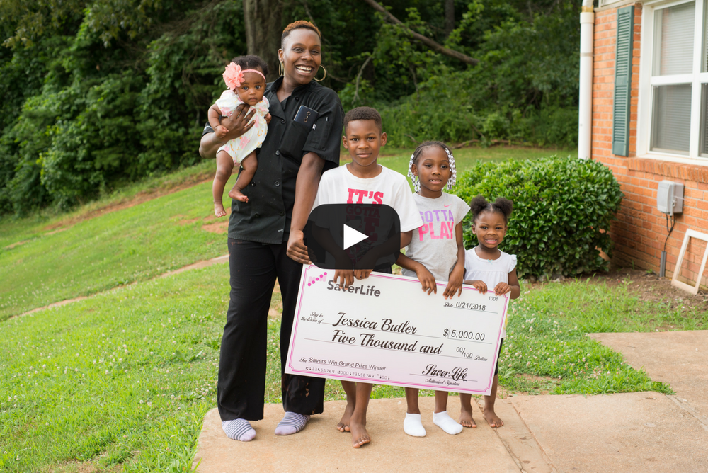 Professional picture of black single mom and her four kids holding up a giant check for $5,000