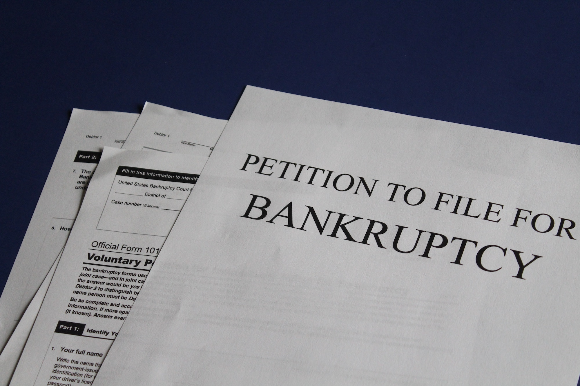Staged pile of bankruptcy petition papers