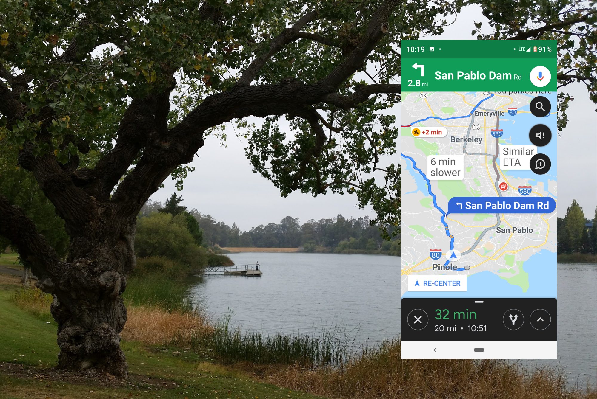 Screenshot of Google Maps showing directions is on one side of a scenic picture of a lake bank