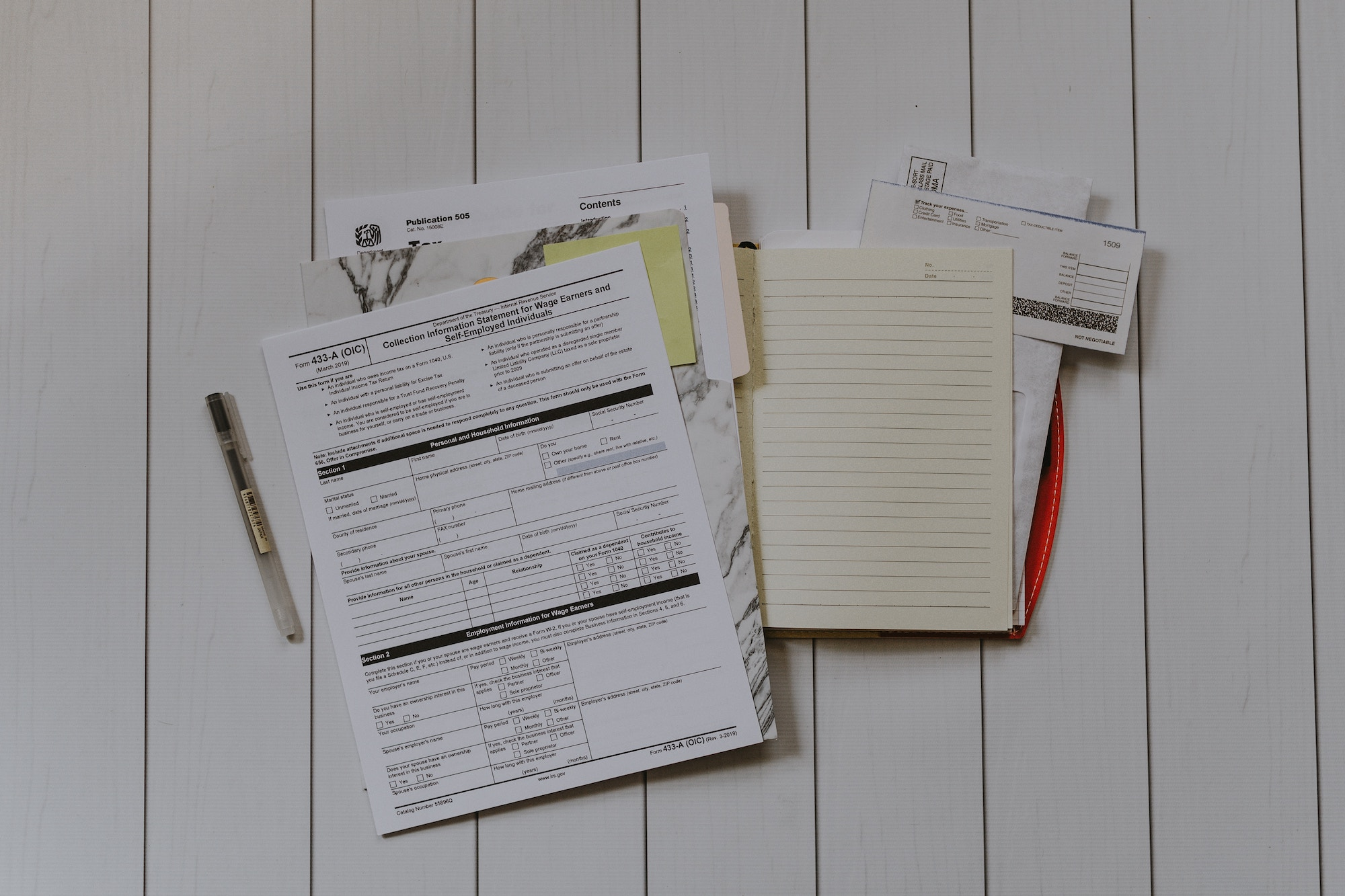 Professional photo taken of various tax documents and forums spread out