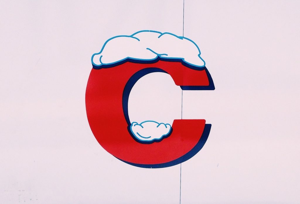 Giant red-colored letter C with snow on top made to represent the three Cs of credit