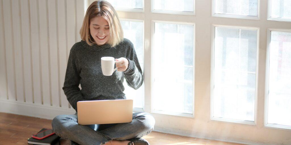 Woman at computer smiling small