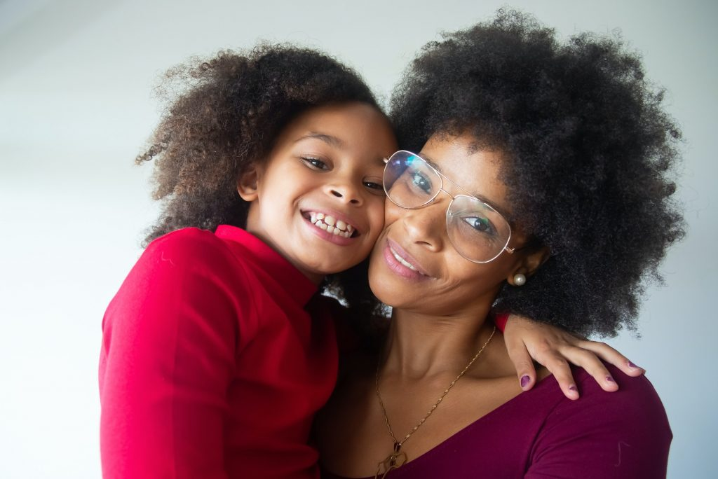 Woman and her daughter smiling