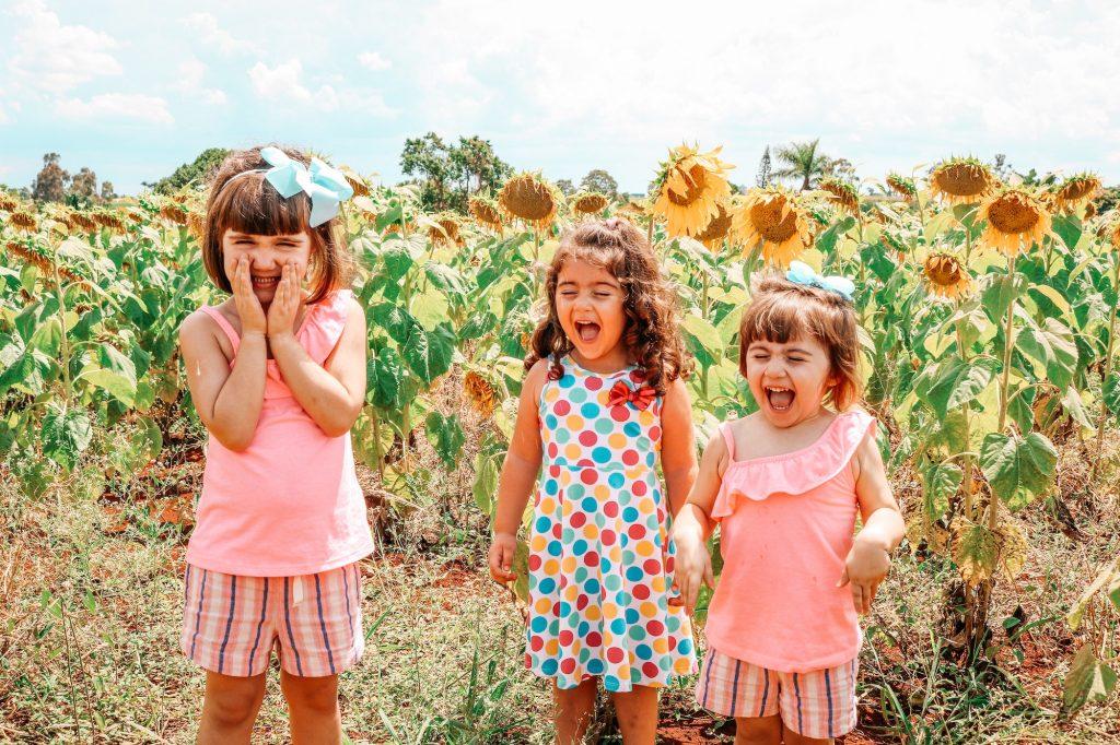 Three Children in field smiling
