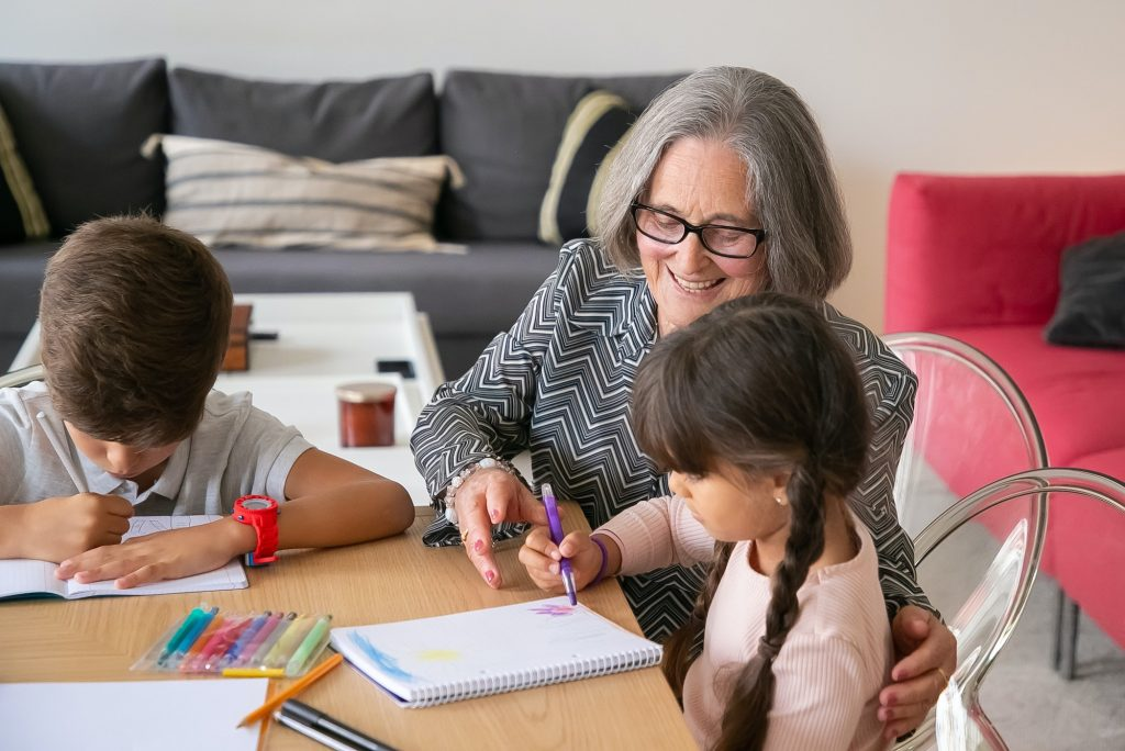 Woman Drawing with Two Kids